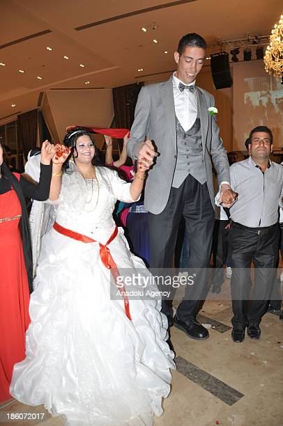 The World's tallest man Sultan Kosen whose height is measured at 2 meters 51 centimeters and Merve Dibo dance during their wedding ceremony on...