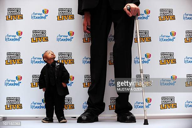 The world�s tallest man, Sultan Kösen standing at 8 ft 1 in poses with shortest man in the world He Pingping standing at 2 ft 5.37 in during the...