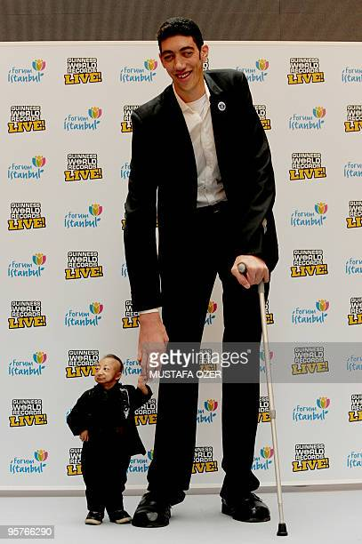 The world�s tallest man, Sultan Kösen standing at 8 ft 1 in poses with shortest man in the world He Pingping standing at 2 ft 5.37 in during...