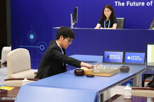 The World's top human player Ke Jie competes against Google's artificial intelligence program AlphaGo during the Future of Go Summit at Wuzhen Town...