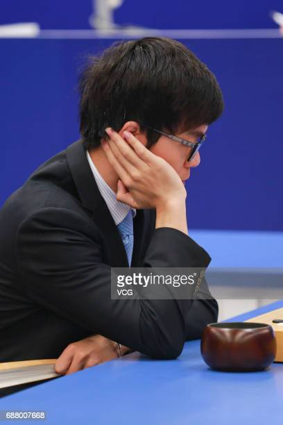The World's top human player Ke Jie competes against Google's artificial intelligence program AlphaGo during the second round match of Google...