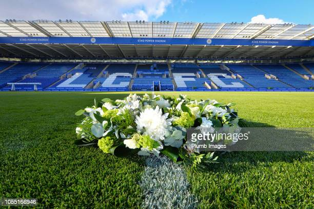 The wreath laid by Leicester City vice chairman Aiyawatt 'Top' Srivaddhanaprabha and mother Aimon Srivaddhanaprabha is seen during a minute's silence...
