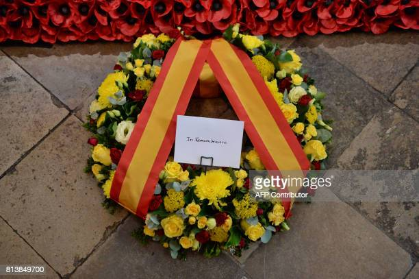 The wreath of flowers laid by the Spanish King Felipe VI at the grave of the Unknown Warrior is seen during his visit to Westminster Abbey in central...