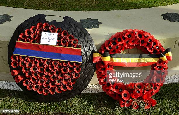 The wreaths from Queen Elizabeth II and King Philippe of Belgium are seen during the opening of the Flanders Field Memorial outside the Guards Chapel...