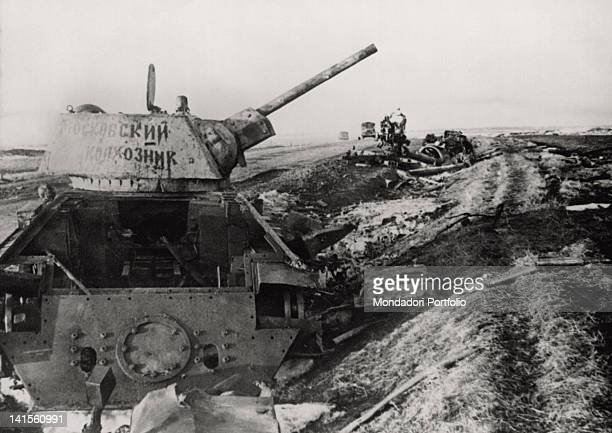 The wreck of a Soviet tank lying by the side of a road in the area between Belgorod and Kharkiv USSR March 1943