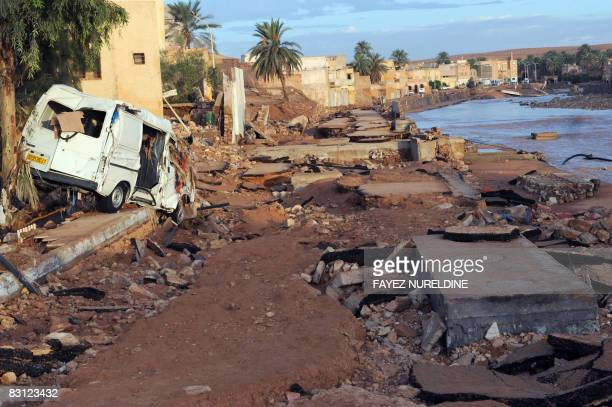 The wreck of a van lies on the pavement on main street in the center of Ghardaia some 600 km south of Algiers on October 03 2008 At least 31 people...