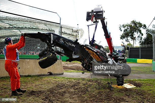 The wreck of Fernando Alonso of Spain and McLaren Honda is retrieved from the circuit during the Australian Formula One Grand Prix at Albert Park on...