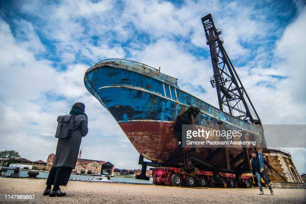 The wreck of the Barca Nostra which sank in 2015 with several hundred migrants on board is on display during the press previews of the 58th...