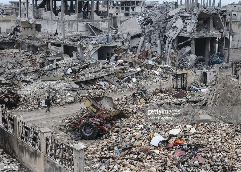 The wreckage left by fighting is seen in the center of the Syrian town of Kobani (Ayn al-Arab) on February 18, 2015 after it has been freed from Islamic State of Iraq and the Levant (ISIL) forces. While civilians in the eastern parts of the city are refusing entrance to the area on suspicion of a trap, houses in other areas are being presented ready for use by their owners.