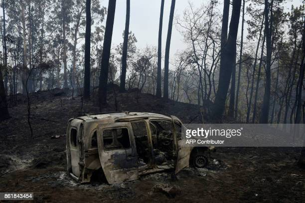The wreckage of a burned van where two people died trapped by flames is pictured in Chandebrito near the town of Nigran northwestern Spain on October...