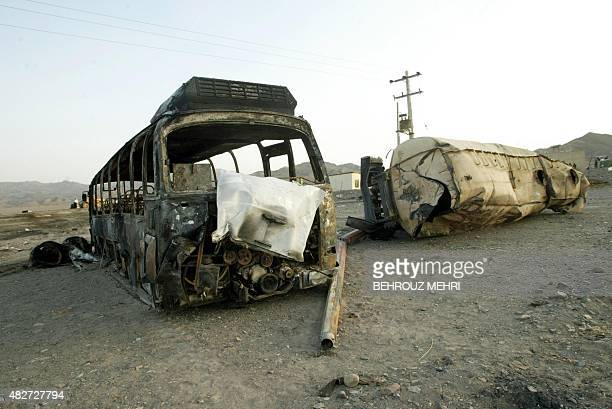 The wreckage of a burnt bus and a gasoline tanker are seen in the Nosrat Abad police post 115km west of the southeastern Iranian border town of...
