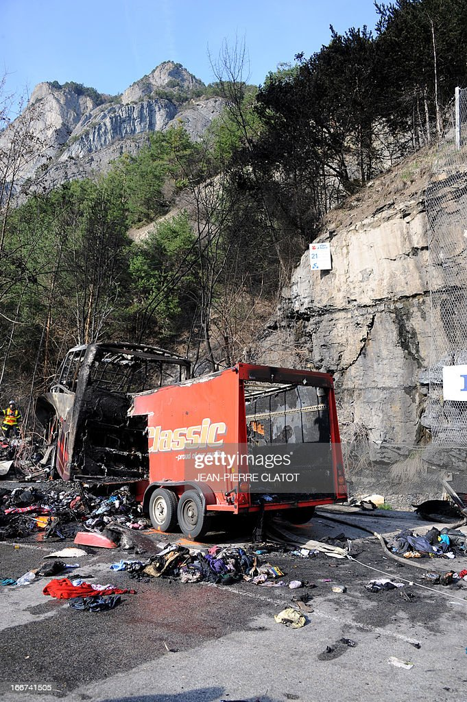 The wreckage of a bus transporting British citizens is pictured after it crashed on April 16, 2013 near Bourg d'Oisans as they were leaving the French Alps resort of l'Alpe d'Huez. The accident killed at least one person, severely wounded three others, and slightly injured 21. In total, 53 people were aboard the bus, including two drivers.
