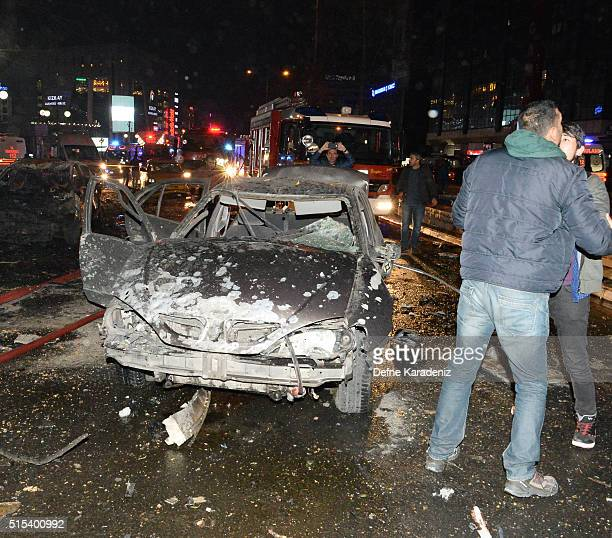 The wreckage of a car is seen after an explosion in Ankara's central Kizilay district on March 13 2016 in Ankara Turkey The Ankara governor's office...