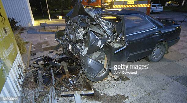 The wreckage of a car that crashed into the wall of the Hastings Exhibition Centre following a short police chase is seen October 13 2005 in Hastings...