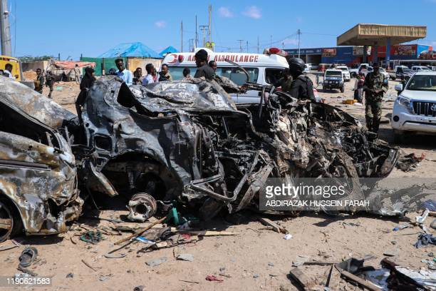 TOPSHOT The wreckage of a car that was destroyed during the car bomb attack is seen in Mogadishu on December 28 2019 A massive car bomb exploded in a...