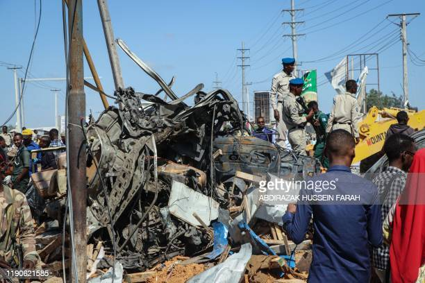 The wreckage of a car that was destroyed during the car bomb attack is seen in Mogadishu on December 28 2019 A massive car bomb exploded in a busy...