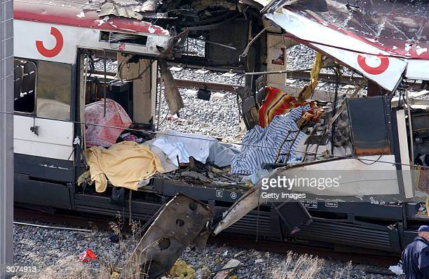 The wreckage of a commuter train is seen March 11 after it was devastated by a bomb blast during the morning rush hour in Madrid Spain Accorcing to...
