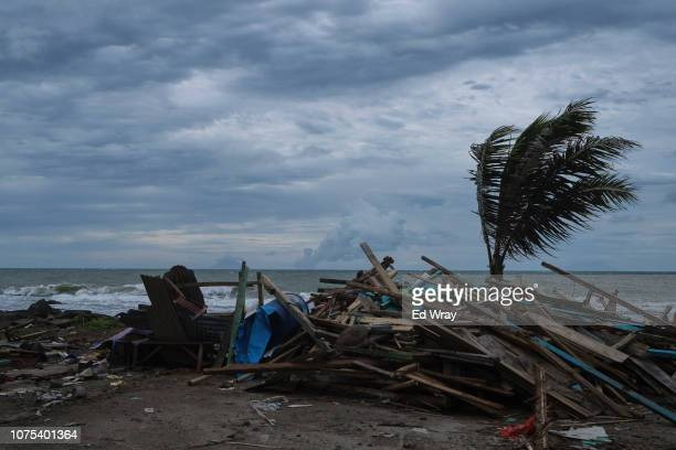 The wreckage of a food stall sits on the beach as the Anak Krakatau volcano emits clouds of hot gas and ash on December 28 2018 in Banten Indonesia...