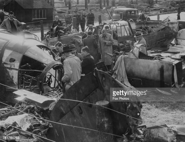The wreckage of a Heinkel He 111 medium bomber and a Junkers JU 87 Stuka dive bomber shot down during the Battle of Britain are examined at a...