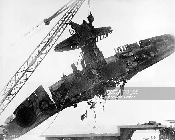 The wreckage of a Japanese torpedo plane shot down during the surprise attack on December 7 being salvaged from the bottom of Pearl Harbor Pearl...