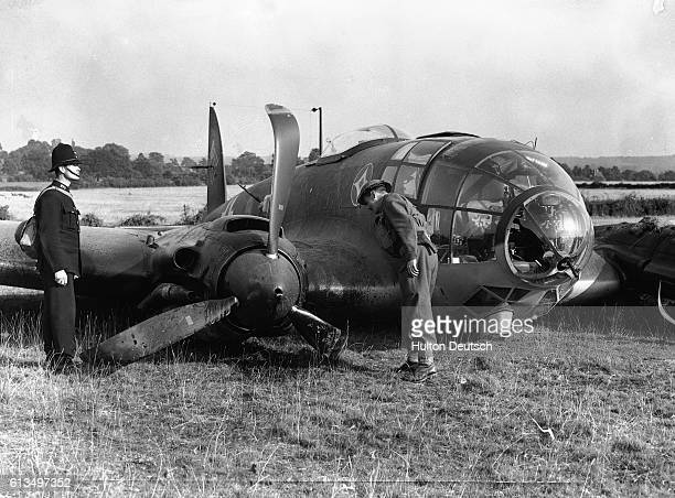 The wreckage of a Luffwaffe Heinkel 111 bomber one of a formation that attacked Biggin Hill lies in a Surrey field August 30 1940