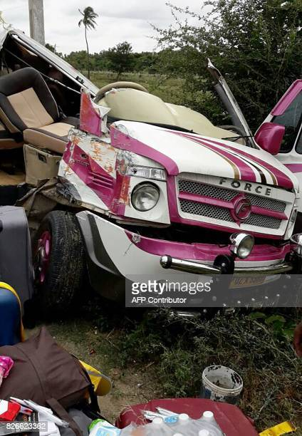 The wreckage of a minibus in which a group of Spanish tourist were travelling is seen after it collided with a container truck in Punganur situated...