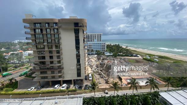 The wreckage of a partially collapsed building in Surfside north of Miami Beach, Florida on June 25, 2021. - Four people are now known to have died...