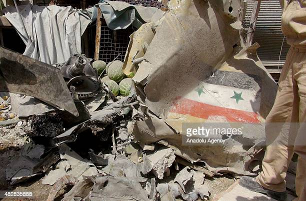 The wreckage of a plane belonging to the Syrian regime forces is seen after it crashed into a market in the oppositioncontrolled Eriha district of...