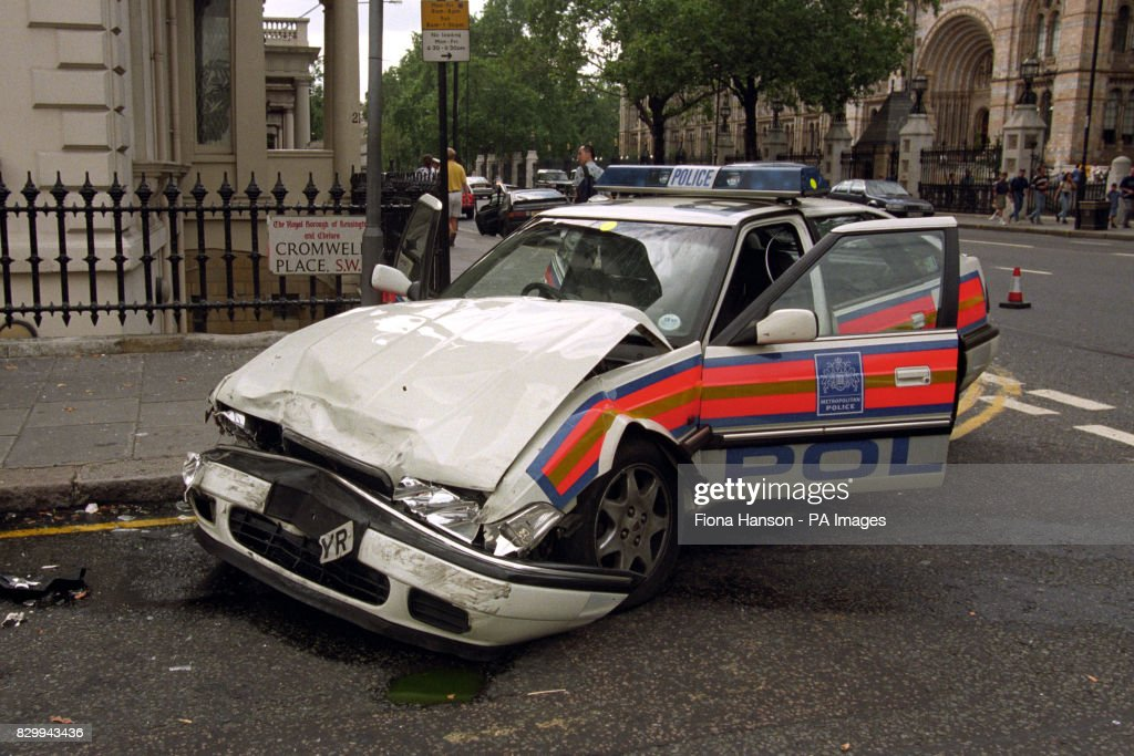 The wreckage of a police car in Cromwell Place south west London