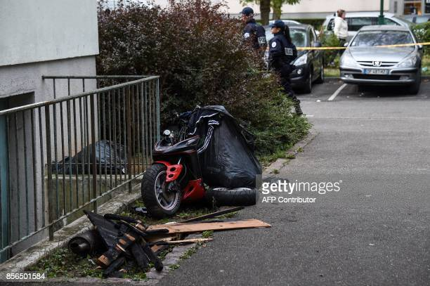 The wreckage of a scooter is pictured near a building where a fire broke out overnight killing five people in Mulhouse on October 2 2017 / AFP PHOTO...