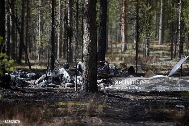 The wreckage of a small airplane is pictured in a forest next to Jämijärvi Airfield southwest Finland on April 21 2014 The Comp Air 8 plane taking a...