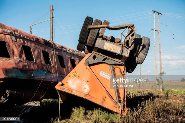 The wreckage of a trailer which was being pulled by a truck after an accident with a train near Kroonstad in the Free State Province some 110kms...