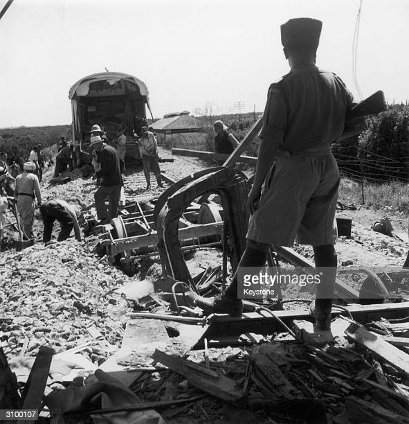 The wreckage of a troop train on the CairoHaifa line near Rehovot in southern Palestine 24th April 1947 Five British soldiers were killed in the...