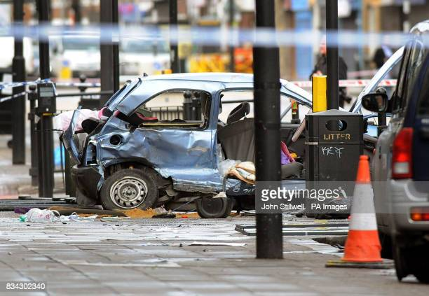 The wreckage of a Vauxhall Corsa remains at the scene in Bethnal Green Road east London after a black Mercedes fourwheel drive jeep being pursued by...
