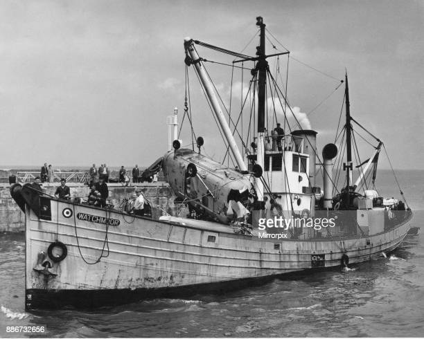 The wreckage of a Westland Whirlwind HAR10 of 228 Search and Rescue salvage from the sea floor is brought into Bridlington harbour by the RAF Salvage...