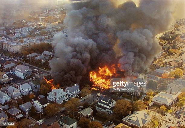 The wreckage of American Airlines flight 587 burns November 12 2001 in the Rockaway neighborhood of the Queens section of New York City The Airbus...