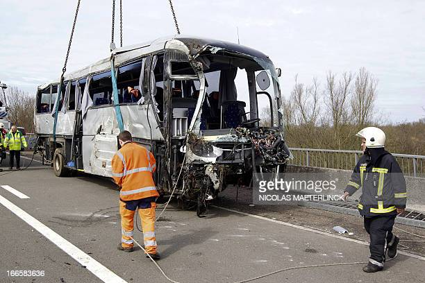 The wreckage of an accident is shown after a bus crashed off the E34 highway near Ranst Antwerp province on April 14 2013 At least five people died...