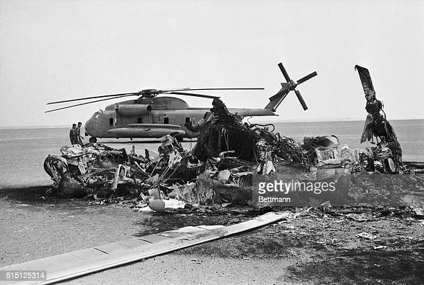 The wreckage of an American helicopter lies on the desert floor after an aborted attempt to rescue hostages from Tehran The helicopter collided with...