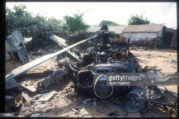 The wreckage of an American helicopter sits October 14 1993 in Mogadishu Somalia This Blackhawk helicopter which was used to root out ammo caches was...