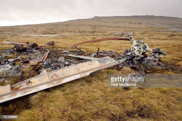 The wreckage of an Argentine Chinook helicopter is still visible on mountains near Stanley 25 years after the war on February 6 2007 in the Falkland...