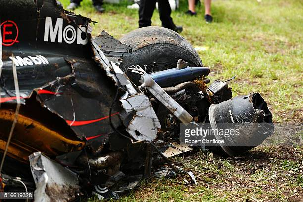 The wreckage of Fernando Alonso of Spain and McLaren Honda by the side of the track during the Australian Formula One Grand Prix at Albert Park on...