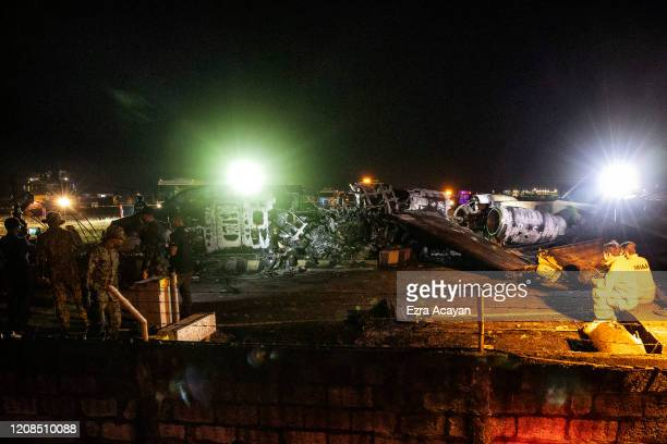 The wreckage of Lion Air Flight RPC 5880 is seen at the runway of Ninoy Aquino International Airport after it crashed on March 29 2020 in Manila...