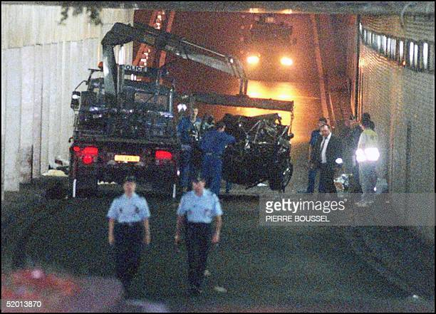 The wreckage of Princess Diana's car is lifted on a truck 31 August in the Alma tunnel of Paris Princess Diana died a few hours after the crash at...