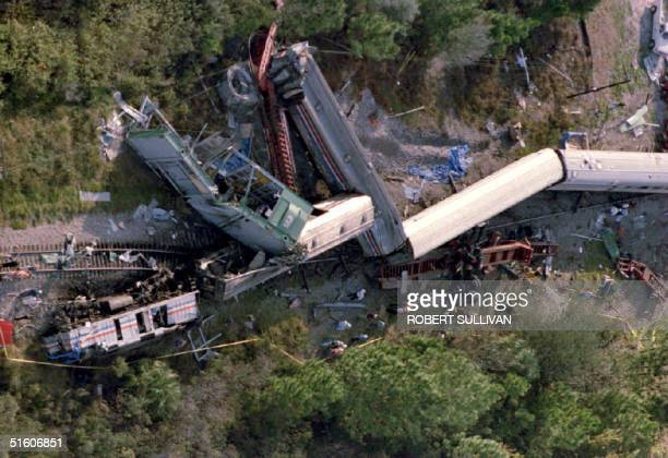 The wreckage of the Amtrak Silver Meteor lies on its side after derailing in Kissimmee Florida 30 November 1993 after colliding with a tractortrailer...
