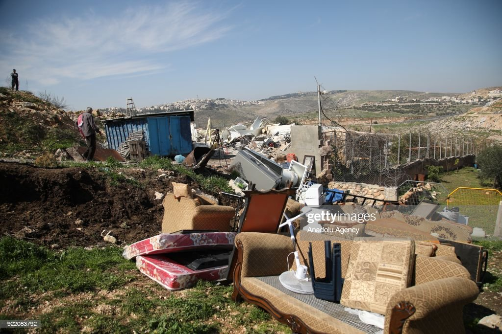 The wreckage of the house and its belongings are seen after heavy duty machines that belong to Israeli forces demolished a Palestinian family's house with the claim of being unlicensed in the Shuafat neighborhood, Eastern Jerusalem on February 21, 2018.