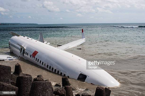 The wreckage of the Lion Air plane lies half submerged in the sea on April 15 2013 in Badung Bali Indonesia The Lion Air passenger plane with over...