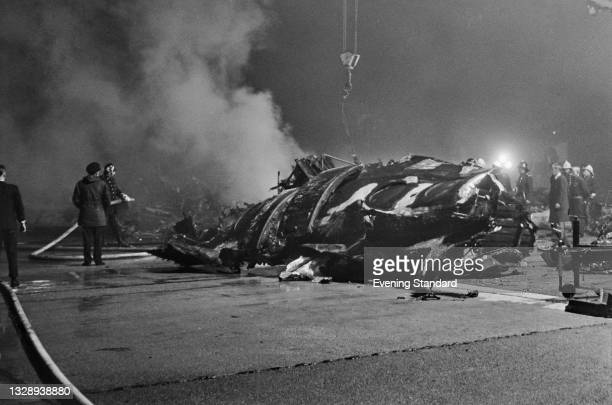The wreckage of Vickers Vanguard G-APEE after a BEA flight from Edinburgh crashed during landing at London Airport , UK, 27th October 1965. All 36...