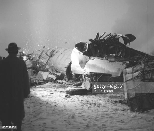 The wrecked BAE Elizabethan airliner that crashed at Munich Airport while bringing home members of the Manchester United football team from a...