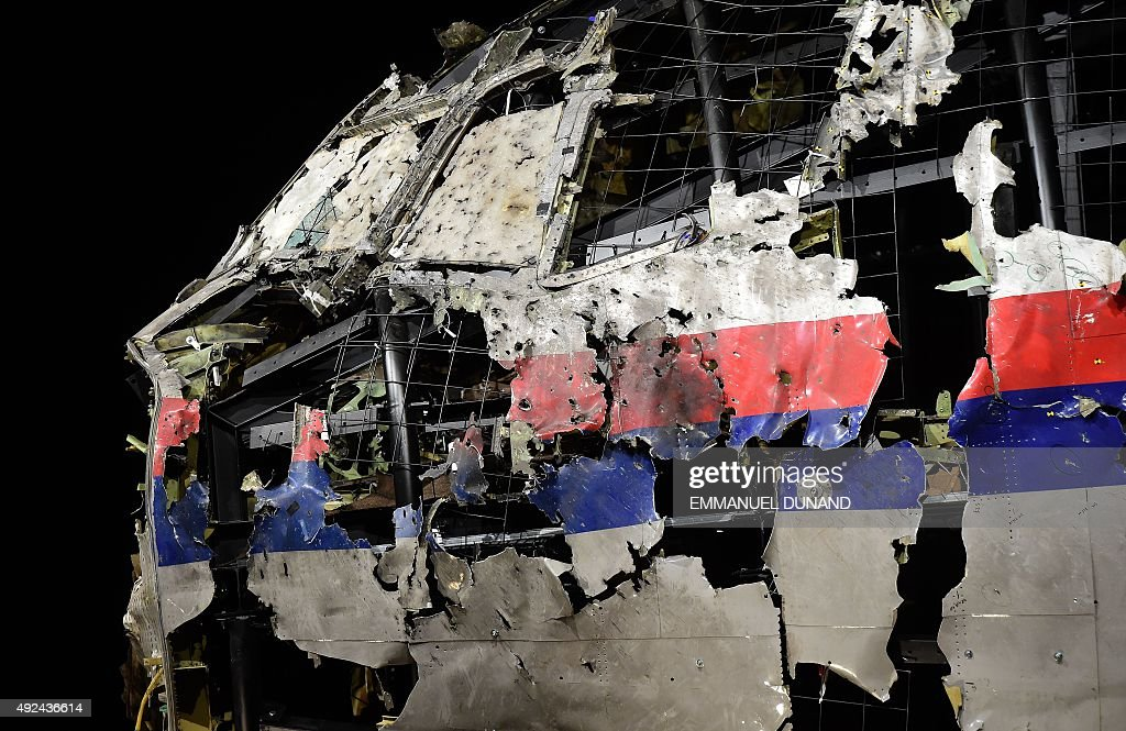 The wrecked cockipt of the Malaysia Airlines flight MH17 is exhibited during a presentation of the final report on the cause of the its crash at the Gilze Rijen airbase October 13, 2015. Air crash investigators have concluded that Malaysia Airlines flight MH17 was shot down by a missile fired from rebel-held eastern Ukraine, sources close to the inquiry said today, triggering a swift Russian denial. The findings are likely to exacerbate the tensions between Russia and the West, as ties have strained over the Ukraine conflict and Moscow's entry into the Syrian war. / AFP / EMMANUEL
