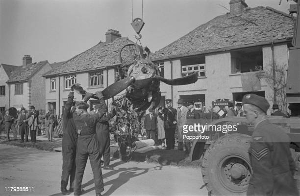 The wrecked engine of a German Luftwaffe Heinkel bomber is removed from the scene after crashing in Victoria Road ClactononSea Essex during World War...